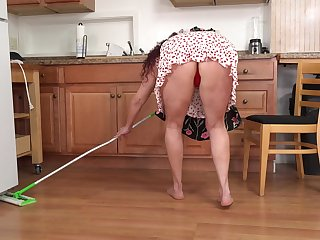 Sexy voluptuous housewife masturbating respecting the kitchen