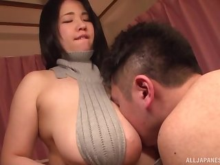 Japanese Yuuki Iori stuffs her tits in a guy's mouth and gives head